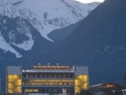 The new library at Quest University is a glowing beacon amidst the snow-capped peaks of the Garibaldi Highlands.