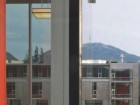 Looking past the library toward the academic building with a view of the moun-tains beyond.