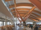 The expressive steel-and-wood-structure inside the services building.
