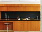 Pristine millwork provides plenty of storage in the linear kitchen.