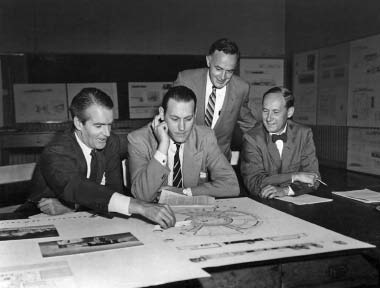 Alfred H. Jarvis, director of the National Gallery of Canada, Peter Dickinson, partner in charge of design at Page & Steele Architects, and R.C. Fairfield of Rounthwaite and Fairfield Architects review competition entries for a community gallery in 1957. James A. Murray, founding editor of Canadian Architect, overlooks the jury's deliberations.