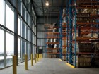 The brightly lit warehousing facility.