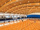 An expansive 100-metre clear span marks a significant milestone in contemporary wooden construction.