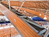 A detail view of the composite glulam-and-steel beams.