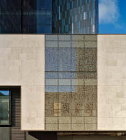 A variety of cladding material was used on the project, ranging from low-iron ultra-clear glass to tyndall stone and a tyndall stone-inspired frit applied to a unitized curtain wall.