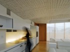 The ALIS touch screen is embedded into the continuous Corian wall surface in the kitchen, which glows with variable intensity as energy systems and water usage of the home are optimized.