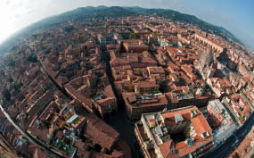 A glorious view of the red-roofed city of Bologna.