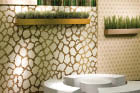 Trend offers a wallpaper-inspired finish through artfully laid tiny mosaic tiles.