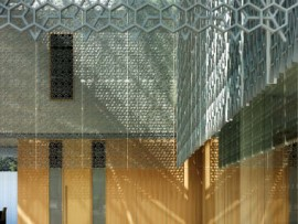 A detail view of the sand-casted aluminum latticework inside the atrium.