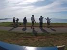Trop de Bleu's team members revel in the breathtaking island landscape.