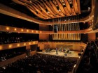 The undulating ribbon-like virtual ceiling of Koerner Hall enhances the sound quality of an intimate concert space.