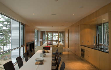 """Kitchen, dining and living areas meld into a single """"interior infrastructure."""""""