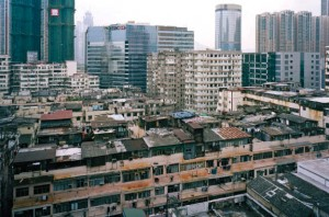 When viewed from a distant rooftop, hundreds of illegal dwellings built atop existing apartment buildings have the cumulative effect of a rural village.