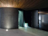 The drum-shaped steam bath is sheathed in tiny textured mosaic tiles.