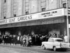 Crowds gather under the famous marquee of Maple Leaf Gardens on Carlton Street in downtown Toronto.