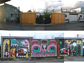 One year after the sheds' completion, a plywood wall was constructed to shield them from public view--upon which artist Joseph Tisiga has painted First Nations motifs.
