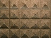 Three detailed images illustrate the variety of effects that Walter has achieved with felt: differing widths of felt strips are woven into a screen, 3D felt wall tiles entitled Grid convey a strong sculptural quality, and leftover strips of variegated felt are laid horizontally in the Striation series.