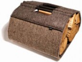 A handsome log carrier fashioned from felt is one of Walter's earlier projects.
