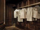 "Inside the store's autonomous fashion ""boxes,"" customers will discover inlaid floors bearing the signature Givenchy logo as well as walls finished with rich wood panelling and painted plaster castings."