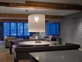 Exposed brick and timber characterizes the project's typical loft interiors.