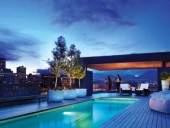 A rooftop pool deck overlooks the downtown eastside.