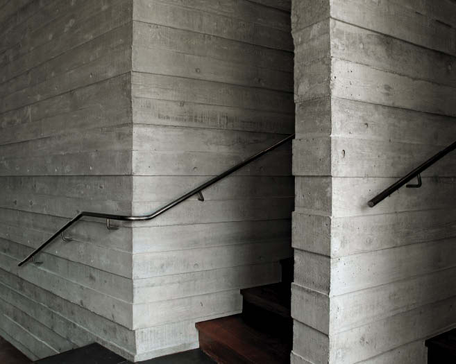 Beautifully textured concrete walls are achieved through the use of artfully constructed plywood formwork.