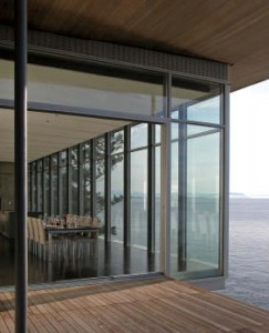 An elegant cantilever accentuates the regularity of the home's formal composition against its more rugged context.