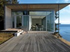 This simple and elegant residence visually frames both itself and the ocean views beyond.