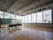The rehearsal room includes both fritted glass for diffuse lighting and expansive clear glazing for breathtaking views of Montreal.