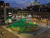 A series of photographs displays the effects of coloured lighting on the civic plaza during evening hours, and each image reveals the linear pathways inscribed in the square's central circle.