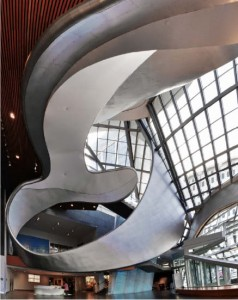 Inside the main lobby, the swirling ribbon-like form offers somewhat of a dynamic spatial experience for visitors. Randall Stout Architects