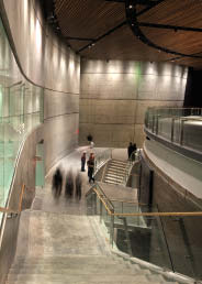 A vast amount of concrete, as seen in this view of the entrance to the Kreeger Theater, provides a strong contrast to the wood and glass aesthetic along the exterior of Arena Stage.