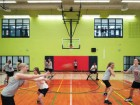 Students participating in one of the school's 26 sponsored sports--basketball.