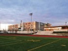 A field house, an eight-lane synthetic track circuit, and multiple artificial turf play fields comprise the school's major outdoor athletic facilities. Extensive stormwater management facilities have been constructed beneath the artificial sports fields and remain largely invisible.