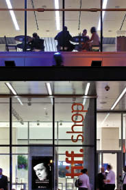 The building successfully engages with the street through ample transparency and signage. Tom Arban