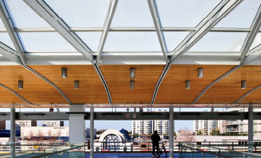 Busby Perkins+Will's three stations in Richmond feature roof enclosures that gently lift at the edges to enhance commuters' views toward the city beyond. Martin Tessler