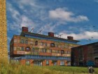 The Brick Works' chimney has become an icon for the redevelopment. The original shell of the red-brick building was maintained to support a new, super-insulated exterior cladding. Diamond and Schmitt Architects
