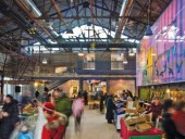 The farmers' market has new hydronic flooring. Steam pipes are trapped in a layer of concrete to provide thermal comfort for thousands of visitors. Diamond and Schmitt Architects