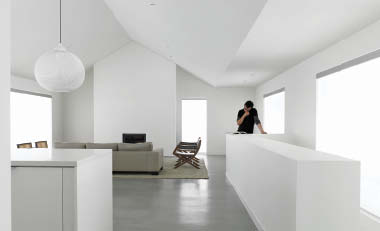 An image of the crisp unadorned interior, a continuation of the blindingly white winter conditions of the surrounding landscape.