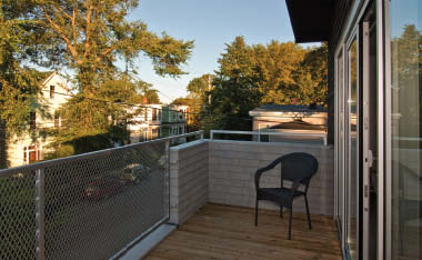 Despite the narrowness of the lot, the house is enhanced by deck spaces on three sides.