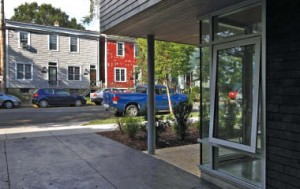 The neighbourhood context is dominated by homes clad in wood siding and lots set tight to the street edge. Mike Dembeck