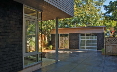 The detached garage and main building are buffered by a small but attractive courtyard.