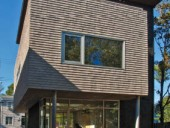 Detailed as an exterior rainscreen wall, the cedar shingles pick up on a vernacular maritime expression of form.