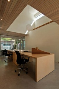 A double-height opening above the ground-floor office space adds considerable volume to the project's interior.