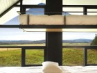 Bunk beds in the children's rooms on the top floor offer enticing views into the distant landscape.