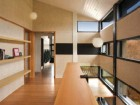 The clean modernity of the residence is evident in this view of the top-floor corridor and stairwell.