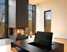 A fireplace projects into the second-floor living room.