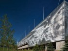 Stunning cloud patterns are digitally imprinted onto the metal screen of the SAIT parkade in Calgary. Nic Lehoux