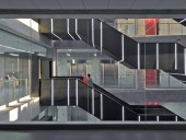Caterpillar-like stairs in the central atrium are punctuated by LED-illuminated strips which help define the building's circulation system.