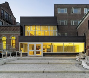 The addition is inserted between the original 19th-century building and the 1950s expansion. The latest addition creates a small but welcoming forecourt to the  college's entrance.